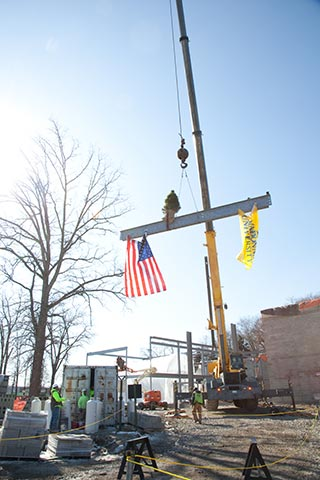 Elevated beam being moved above
