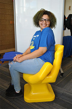 Student Sitting in the Handshake Chair