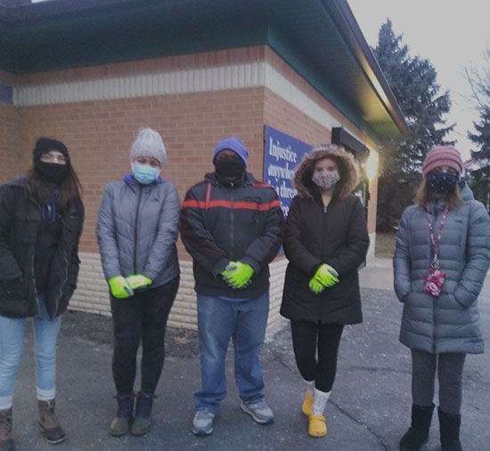 Students standing outside Angela Hospice facility