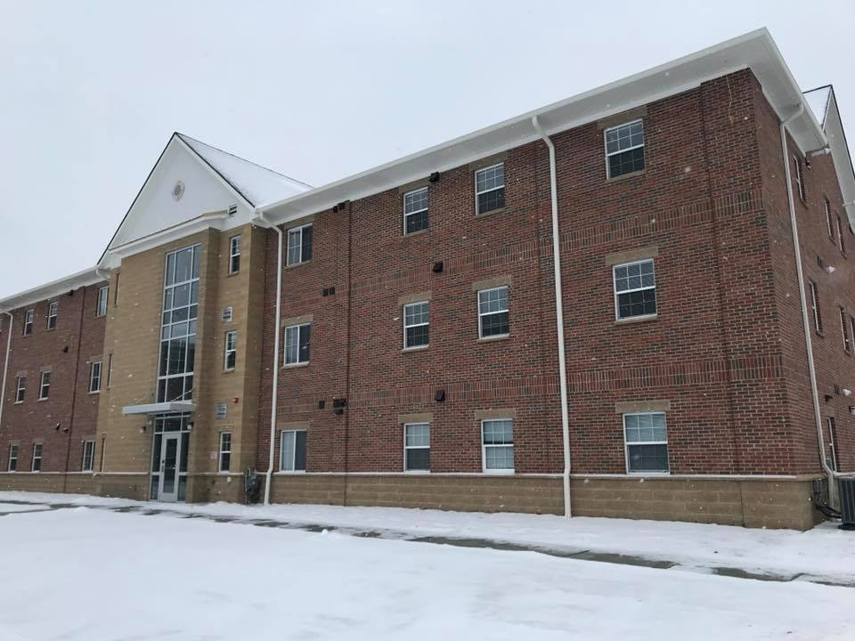 New Student Dorm Building in Winter Scene