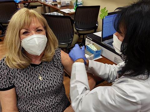 Dr. Dunn receiving COVID-19 vaccine