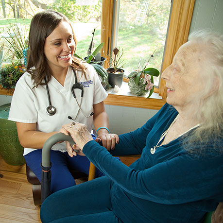 Nursing student working with elderly woman in Hospice setting