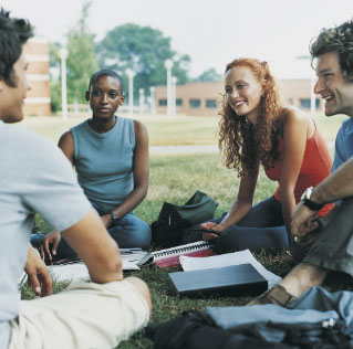 Group of students engaged in discussion outdoors