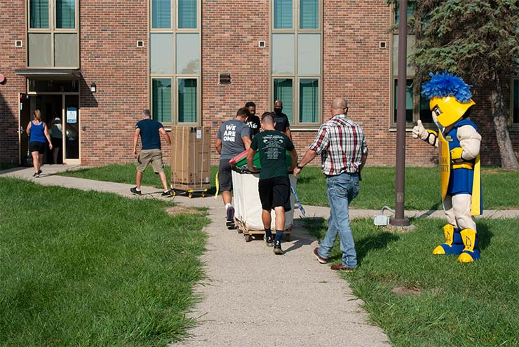 Students moving in to their dorms greeting by Cruzer